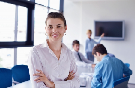 business woman  with her staff,  people group in background at modern bright office indoors Stock Photo - 16523095