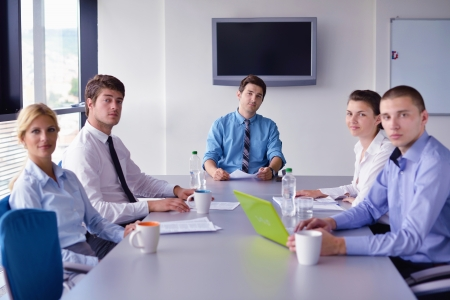 Group of happy young  business people in a meeting at office Stock Photo - 16523025