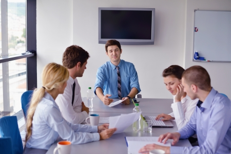 Group of happy young  business people in a meeting at office Stock Photo - 16523046