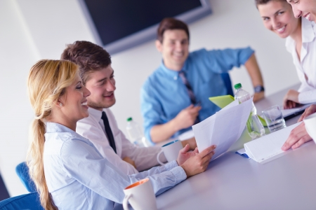 young office workers: Group of happy young  business people in a meeting at office Stock Photo