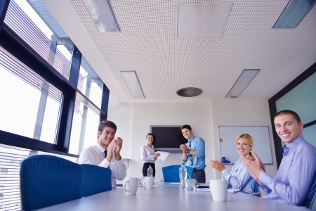 Group of happy young  business people in a meeting at office Stock Photo - 16522938