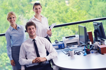 Group of happy young  business people in a meeting at office Stock Photo - 16522979