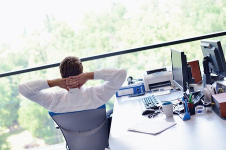 business men: happy young business  man work in modern office on computer Stock Photo