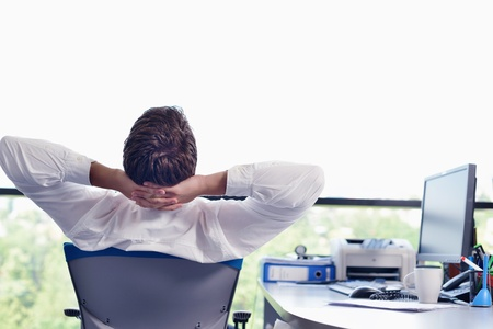 office view: happy young business  man work in modern office on computer Stock Photo