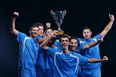 soccer players team group celebrating the victory and become champion of game while holding win coup Stock Photo - 16592703