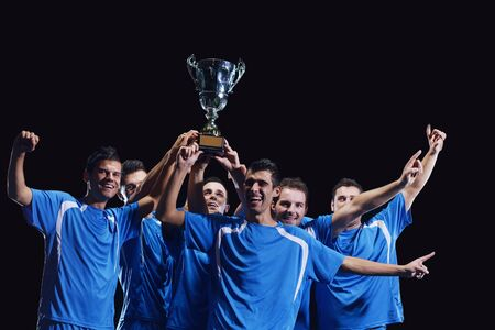 soccer players team group celebrating the victory and become champion of game while holding win coup Stock Photo - 17367145