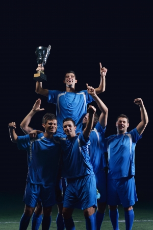 soccer players team group celebrating the victory and become champion of game while holding win coup Stock Photo - 17367146