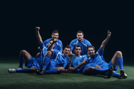 soccer players team group celebrating the victory and become champion of game while holding win coup Stock Photo - 17367149