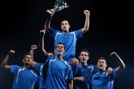 soccer players team group celebrating the victory and become champion of game while holding win coup Stock Photo - 17368394