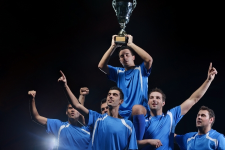 soccer players team group celebrating the victory and become champion of game while holding win coup Stock Photo - 17485657