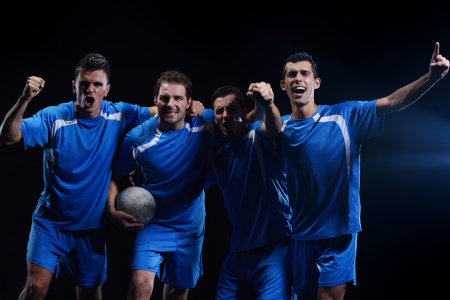 coup: soccer players team group celebrating the victory and become champion of game while holding win coup