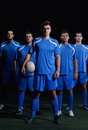 athletic wear: soccer players team group isolated on black background Stock Photo