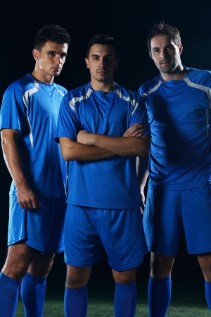 team winner: soccer players team group isolated on black background Stock Photo
