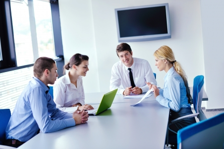 Group of happy young  business people in a meeting at office Stock Photo - 16580983