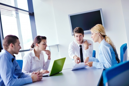 a communication: Group of happy young  business people in a meeting at office Stock Photo