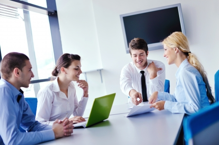Group of happy young  business people in a meeting at office Stock Photo - 16580850