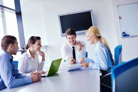 computer education: Group of happy young  business people in a meeting at office Stock Photo