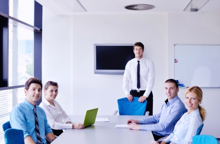 Group of happy young  business people in a meeting at office Stock Photo - 16580372