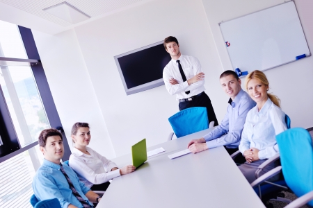 Group of happy young  business people in a meeting at office Stock Photo - 16580848