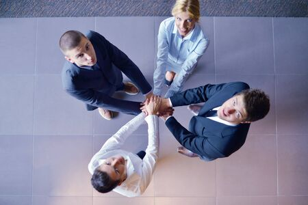business people group joining hands and representing concept of friendship and teamwork,  low angle view Stock Photo - 16581441