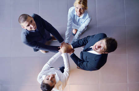 join hand: business people group joining hands and representing concept of friendship and teamwork,  low angle view