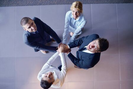 business people group joining hands and representing concept of friendship and teamwork,  low angle view Stock Photo - 16581611