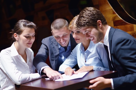 Group of happy young  business people in a meeting at office Stock Photo - 16580837