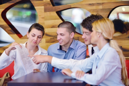 Group of happy young  business people in a meeting at office Stock Photo - 16581606