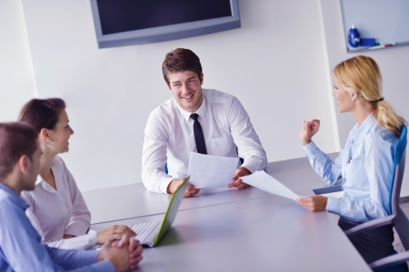 Group of happy young  business people in a meeting at office Stock Photo - 16580543