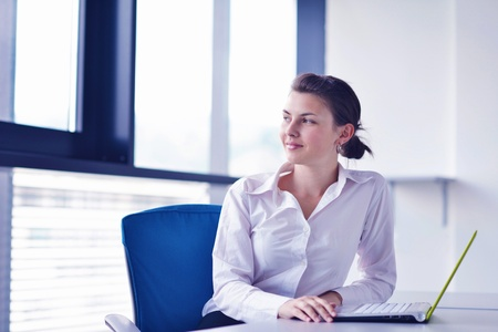Young pretty business woman with notebook in the bright modern office indoors Stock Photo - 20590817