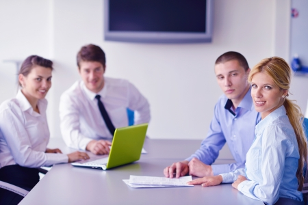 Group of happy young  business people in a meeting at office Stock Photo - 16581366