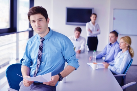 Group of happy young  business people in a meeting at office Stock Photo - 16580989