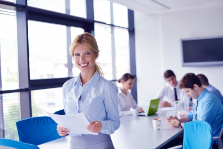 business woman  with her staff,  people group in background at modern bright office indoors Stock Photo - 16580549