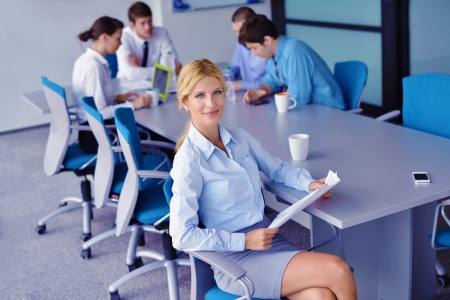 Group of happy young  business people in a meeting at office Stock Photo - 16581629