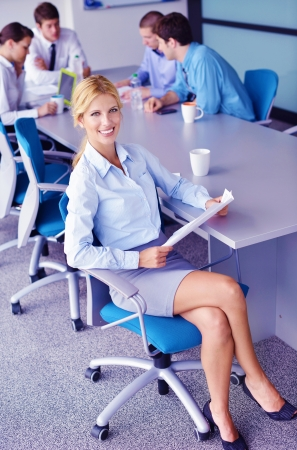 Group of happy young  business people in a meeting at office Stock Photo - 20590820