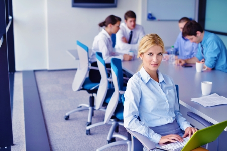 business woman  with her staff,  people group in background at modern bright office indoors Stock Photo - 20590818
