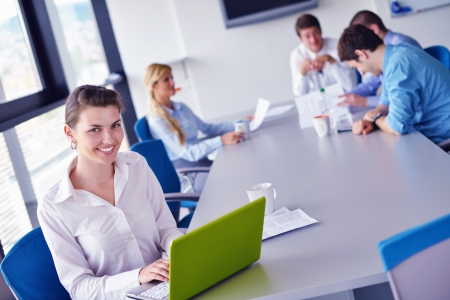Group of happy young  business people in a meeting at office Stock Photo - 16581451