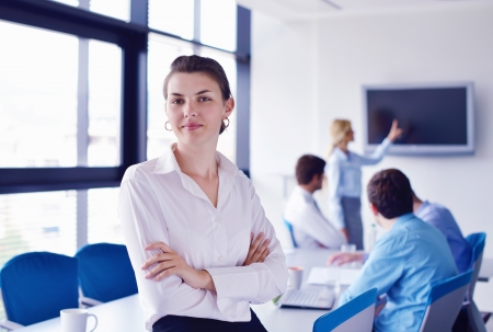 business woman  with her staff,  people group in background at modern bright office indoors Stock Photo - 16581302