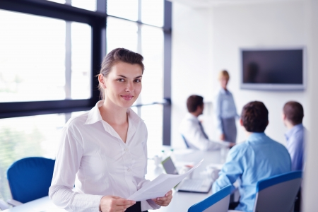Group of happy young  business people in a meeting at office Stock Photo - 16580542