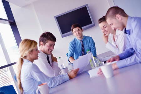 Group of happy young  business people in a meeting at office Stock Photo - 16580548