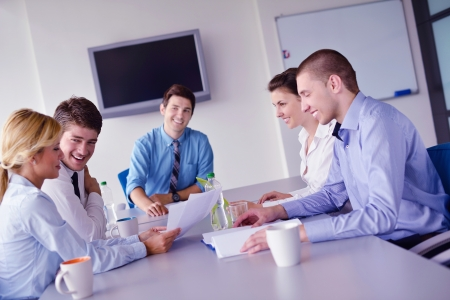Group of happy young  business people in a meeting at office Stock Photo - 16581370