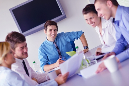 Group of happy young  business people in a meeting at office Stock Photo - 16580605