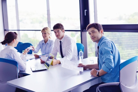 Group of happy young  business people in a meeting at office Stock Photo - 16580550