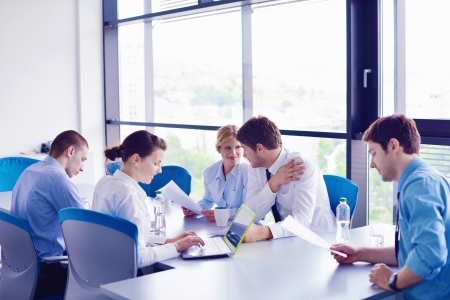 Group of happy young  business people in a meeting at office Stock Photo - 16580599