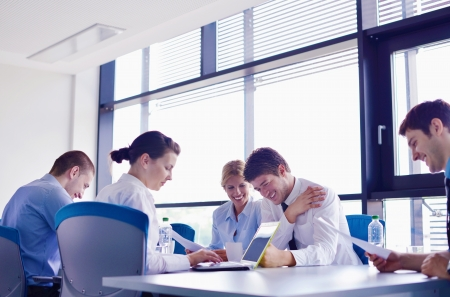 Group of happy young  business people in a meeting at office Stock Photo - 16580603