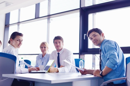 Group of happy young  business people in a meeting at office Stock Photo - 16580540