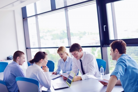 Group of happy young  business people in a meeting at office Stock Photo - 16580607