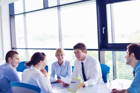 Group of happy young  business people in a meeting at office Stock Photo - 16580504
