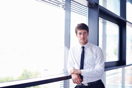 Portrait of a handsome young  business man  on a meeting in offce with colleagues in background Stock Photo - 16580270