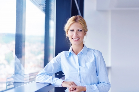 business woman  with her staff,  people group in background at modern bright office indoors Stock Photo - 16581565
